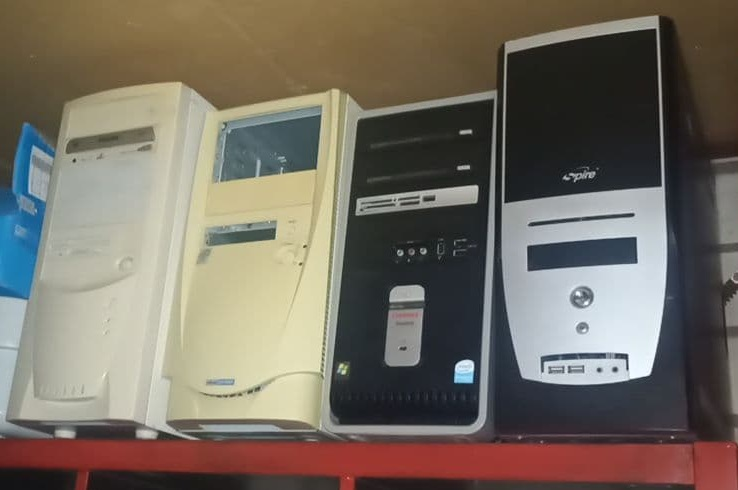 Picture showing 4 computers with out of date designs.